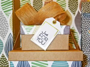 stacks of gift boxes with the writing 'Just for You'